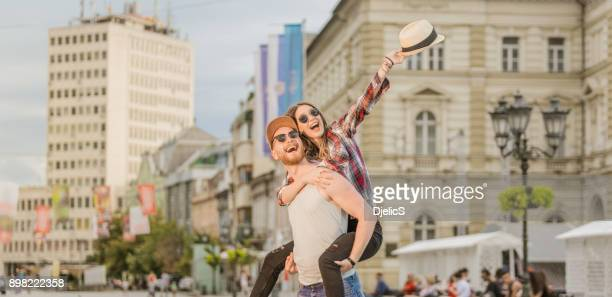 Happy young couple having fun in the city