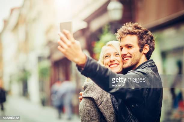 Happy young couple having fun taking selfie