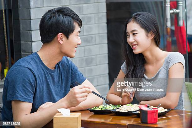happy young couple having lunch - chopsticks stock pictures, royalty-free photos & images