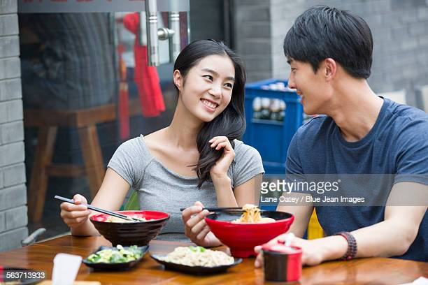 Happy young couple having lunch