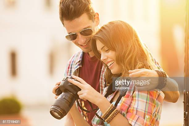 Happy young couple holding a camera