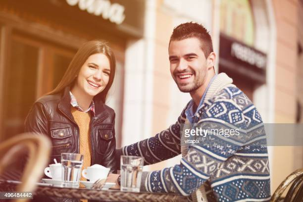 happy young couple in a cafe - coffee drink stock pictures, royalty-free photos & images