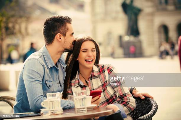happy young couple in a city cafe - coffee drink stock pictures, royalty-free photos & images