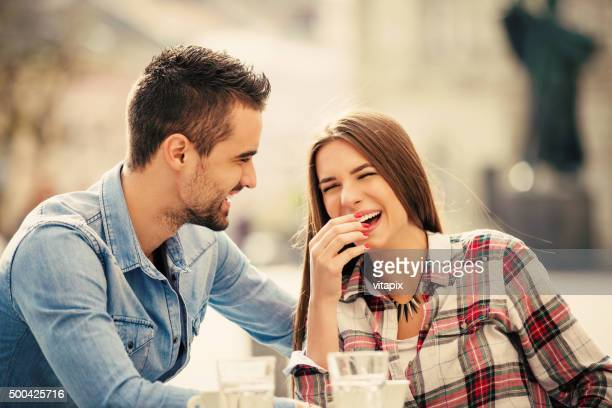 Happy young couple in a city cafe