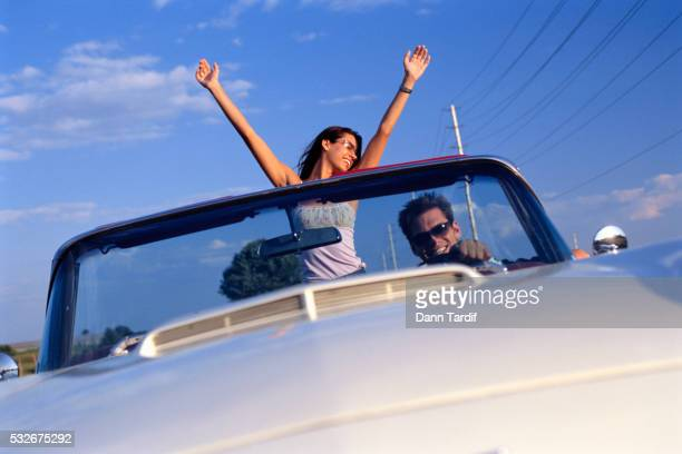 Happy Young Couple in Convertible