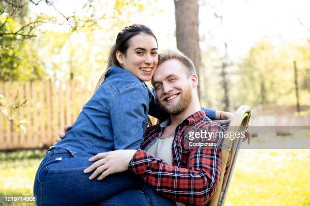 happy young couple in love in the garden. - heterosexual couple stock pictures, royalty-free photos & images