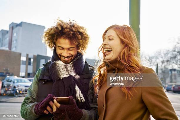 happy young couple in winter clothes outdoors - 20 29 years stock pictures, royalty-free photos & images