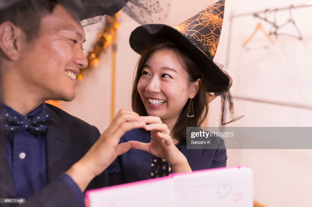 Happy young couple looking at each other at party : Stock Photo