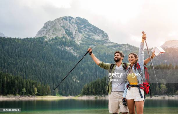 happy young couple love hiking together. - montenegro imagens e fotografias de stock