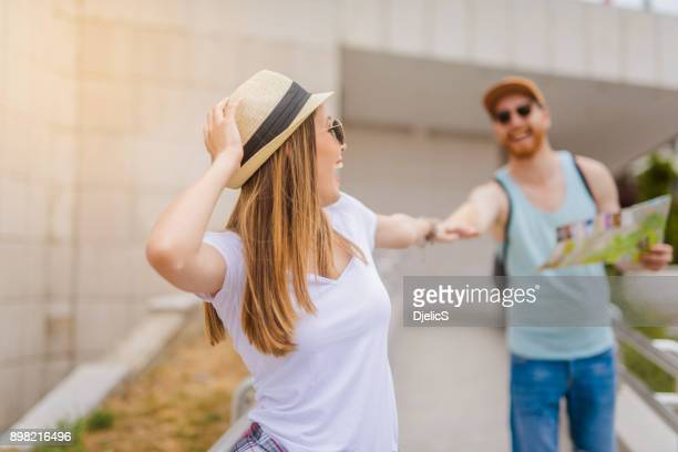 Happy young couple love traveling together