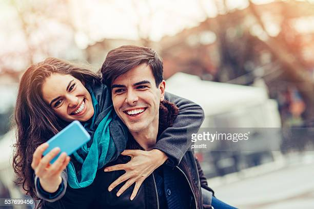 Happy young couple making selfie