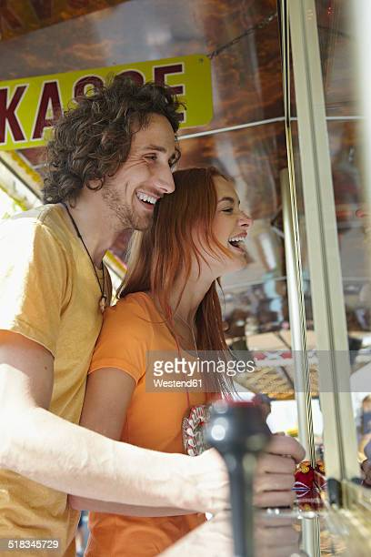 Happy young couple on a funfair