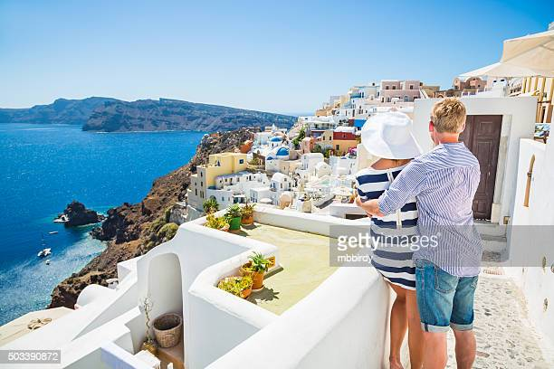 happy young couple on santorini island, greece - greece stock pictures, royalty-free photos & images