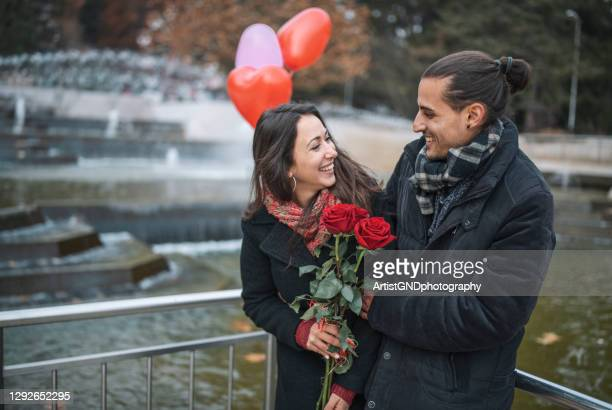 happy young couple on valentine`s day. - valentine' day stock pictures, royalty-free photos & images