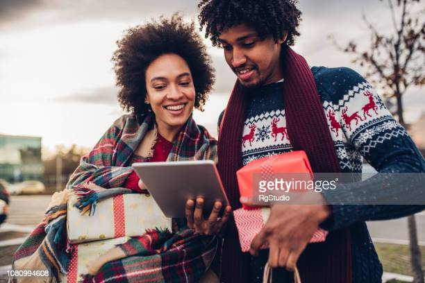 Happy young couple online shopping for Christmas presents