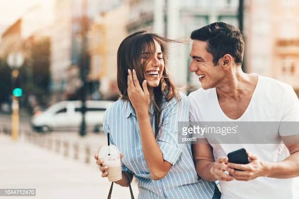 happy young couple outdoors on a sunny day - candid forum stock pictures, royalty-free photos & images