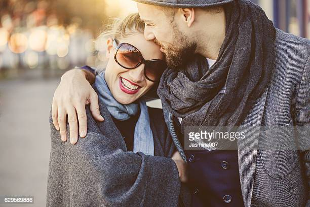 happy young couple outdoors - elegantie stockfoto's en -beelden