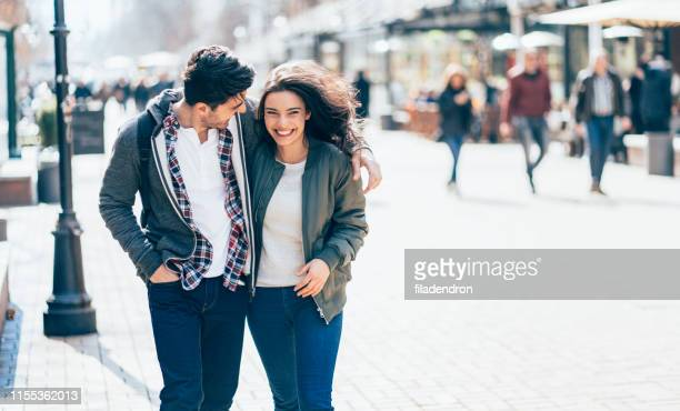 happy young couple - jacket stock pictures, royalty-free photos & images
