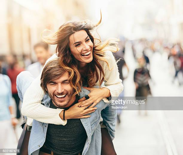 happy young couple - piggyback stock pictures, royalty-free photos & images