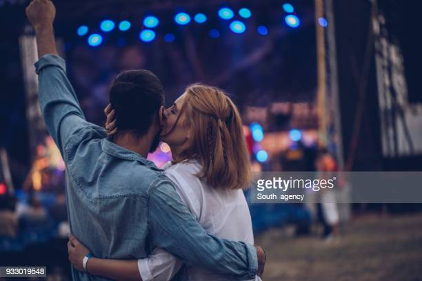 happy young couple - music festival stock pictures, royalty-free photos & images