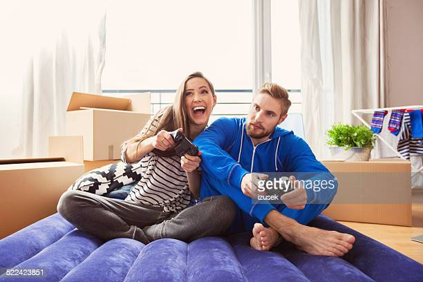 Happy young couple playing playstation