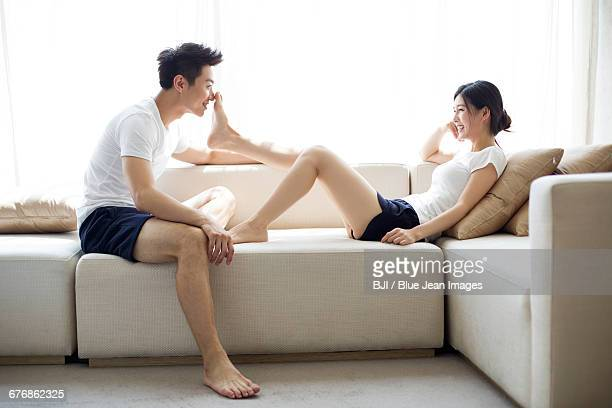 happy young couple relaxing at home - asian women feet stock pictures, royalty-free photos & images