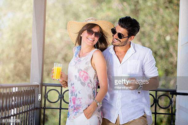 happy young couple smiling at the terrace - terrassenfeld stock-fotos und bilder
