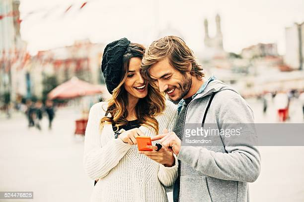 Happy young couple texting