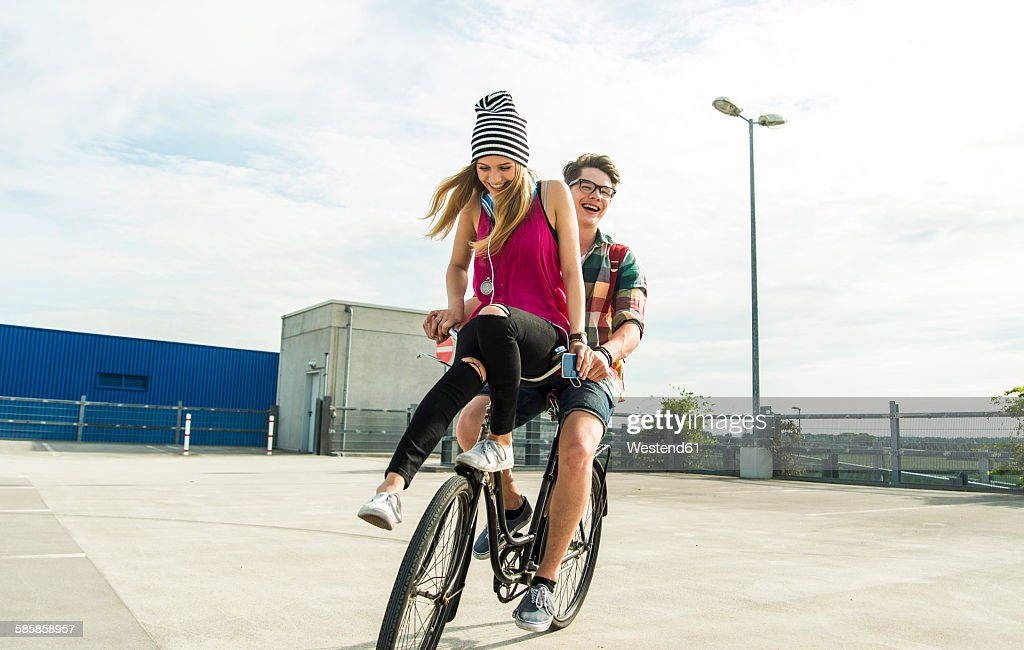 Happy young couple together on a bicycle : Stock Photo