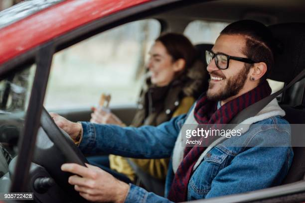 happy young couple traveling by car - driving stock pictures, royalty-free photos & images