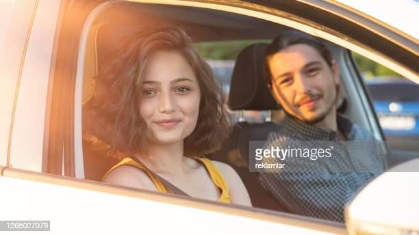 happy young couple traveling by car, sunset. - middle east stock pictures, royalty-free photos & images