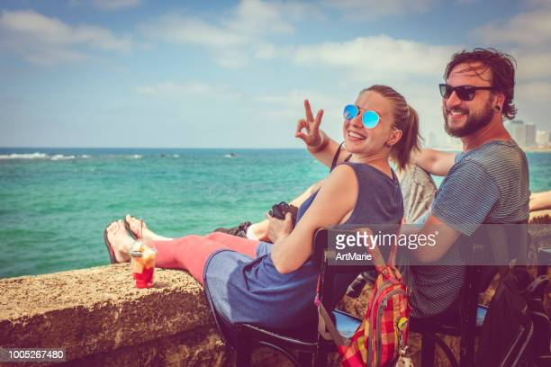 happy young couple traveling - tel aviv stock pictures, royalty-free photos & images