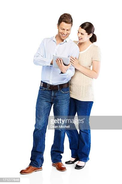 Happy young couple using tablet computer