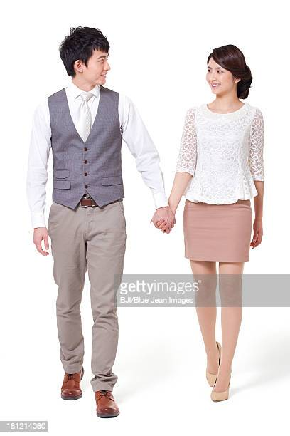 Happy young couple walking, hand in hand