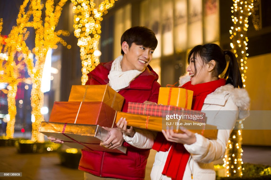 Happy young couple with new year gifts : Stock Photo