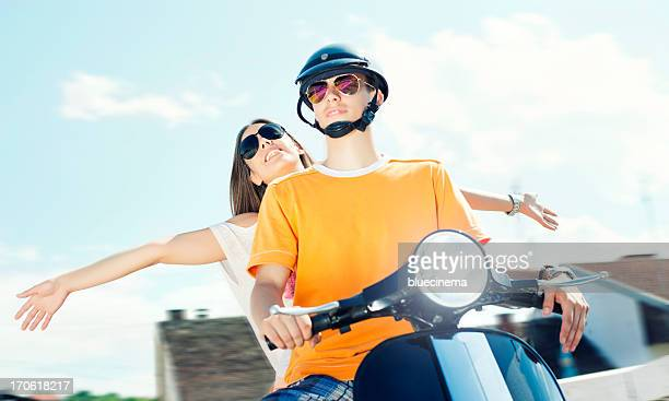 happy young couple with scooter - moped stock photos and pictures