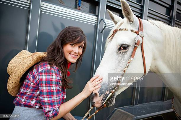 Happy, Young Cowgirl with Horse and Trailer