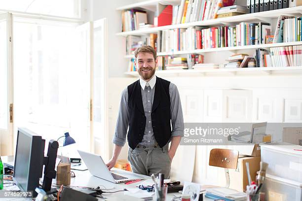 Happy young designer in his studio.