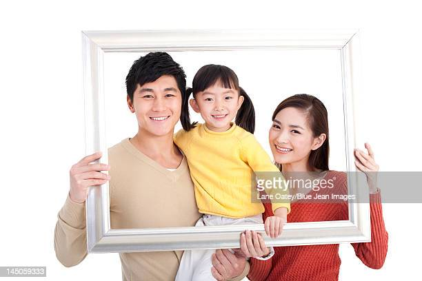 Happy young family and picture frame