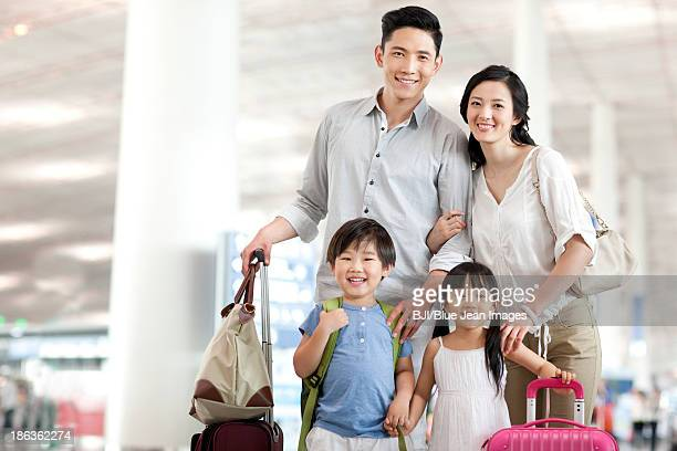 Happy young family at the airport