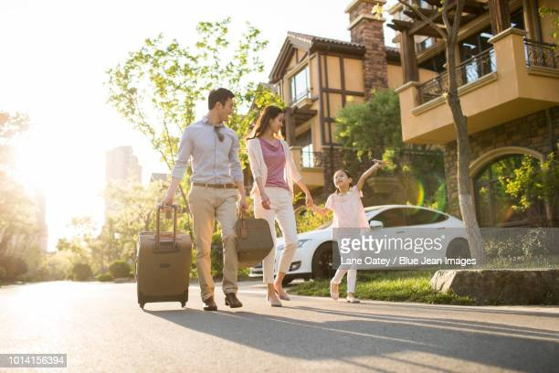 happy young family going for vacation - close to stock pictures, royalty-free photos & images