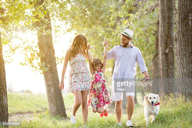 Happy young family on a summer day with their dog