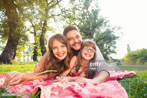 Happy young family on picnic