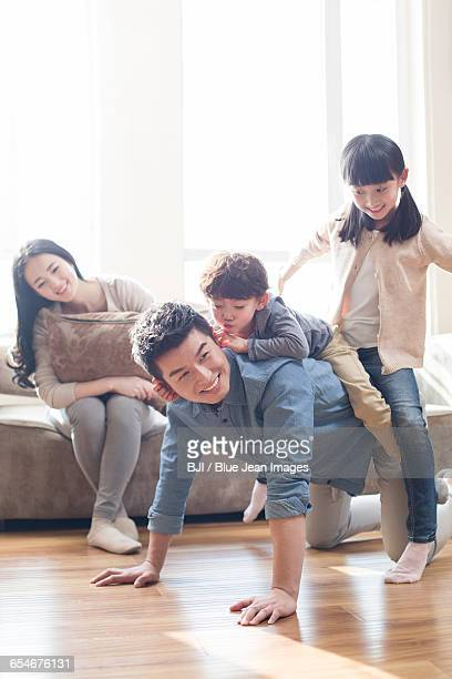 happy young family - girl wrestling stock pictures, royalty-free photos & images