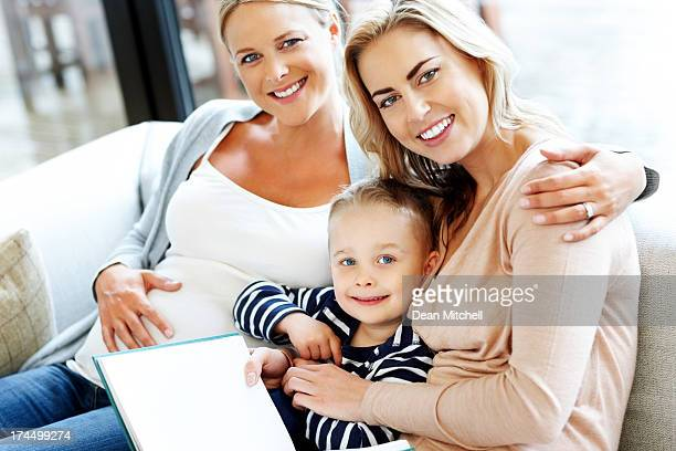 Happy young family sitting together