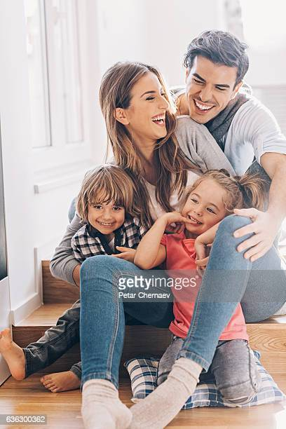 Happy young family with two small children