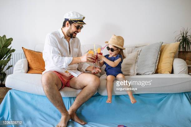 happy young father with daughter having fun time at living room - reportaje imágenes stock pictures, royalty-free photos & images