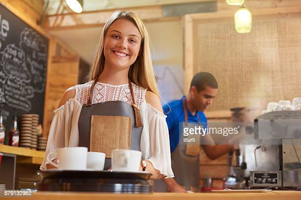 happy young female barista