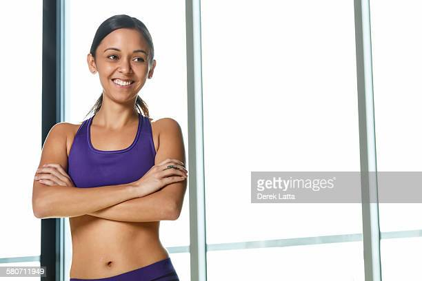 Happy young female in workout attire