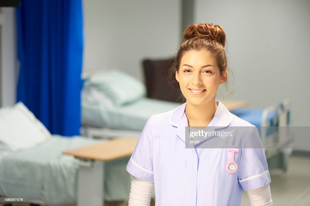 happy young female nurse : Stock Photo